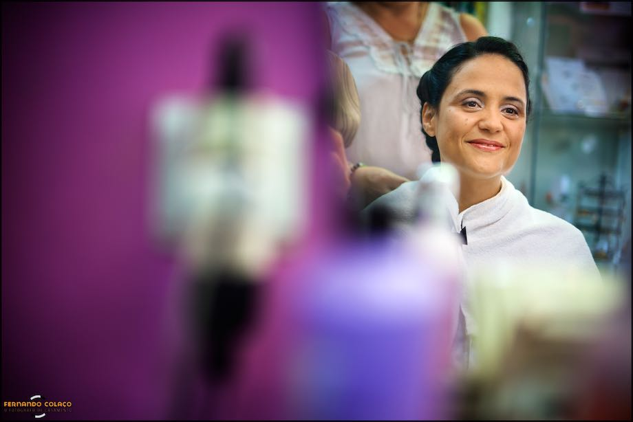 Bride, at the hairdresser, surrounded by purple colors.