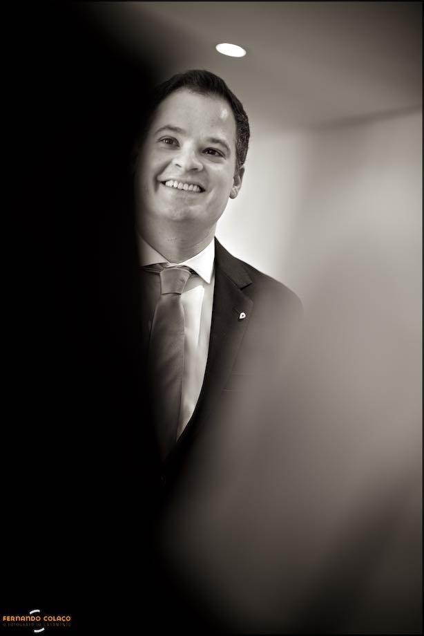 Portrait of the groom with a happy face before the departure for the ceremony.