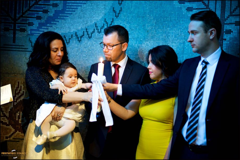 Baby girl with parent and godparents, after the baptism.