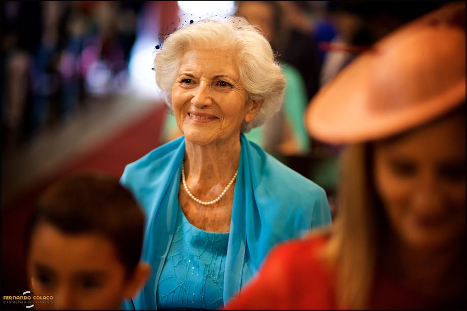 Grand mother of the bride smiling in the wedding ceremony at church.