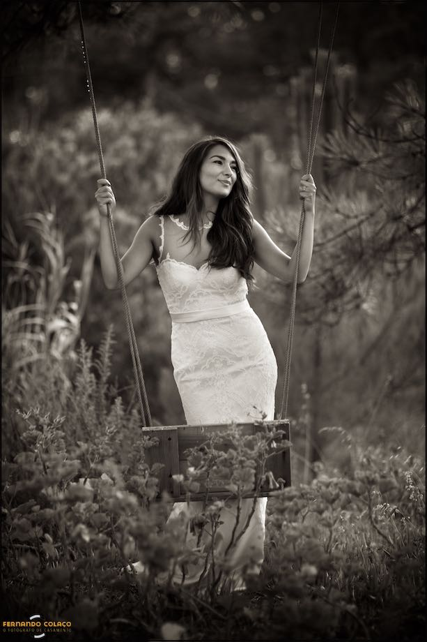 Bride, standing, holding a swing.