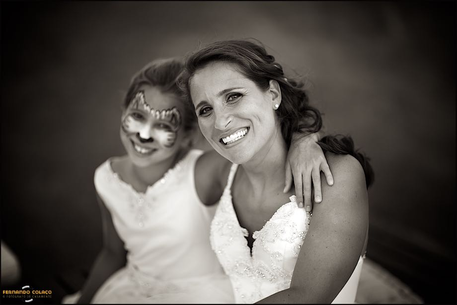 Bride with her daughter, with the face painted.
