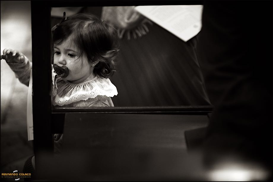 Little girl playing in a wedding ceremony.